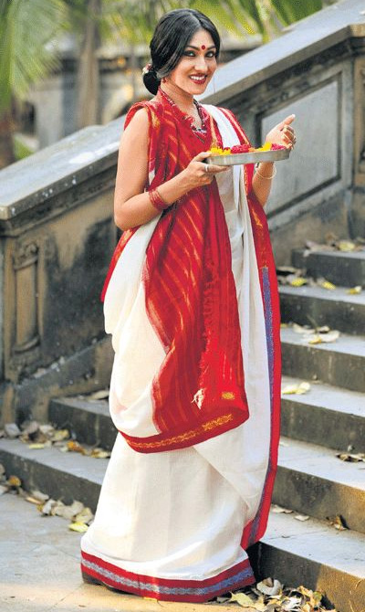 0700137ee8 The women of Bengal wear Sarees of various materials such as silk, Taant  Cotton, chiffon, etc. The most popular modern draping method of Sarees  originates ...